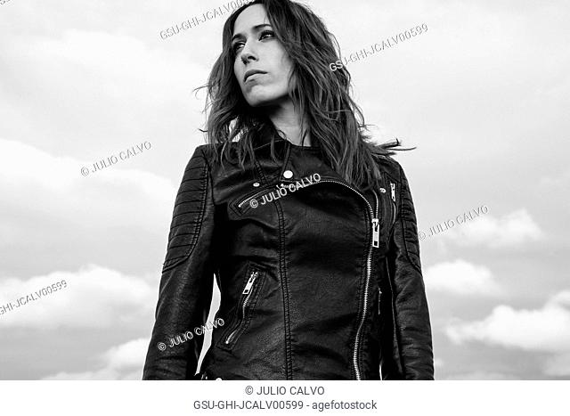 Waist-Up Portrait of Young Adult Woman in Black Leather Jacket