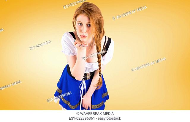 Composite image of oktoberfest girl blowing a kiss