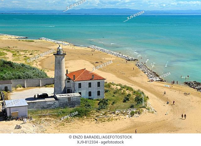 Aerial view of lighthouse of Bibione. In the background the coast of Friuli