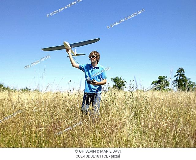 Man playing with remote-controlled plane