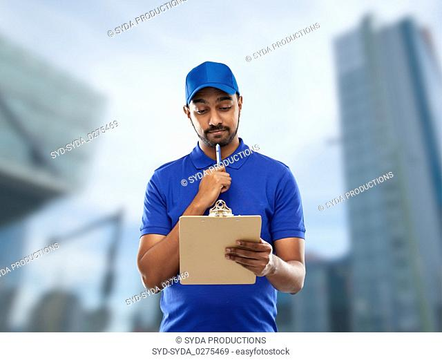 indian delivery man with clipboard in blue
