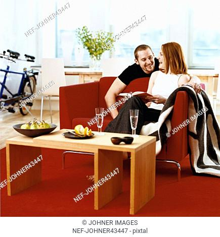Man and woman hanging out in the living room