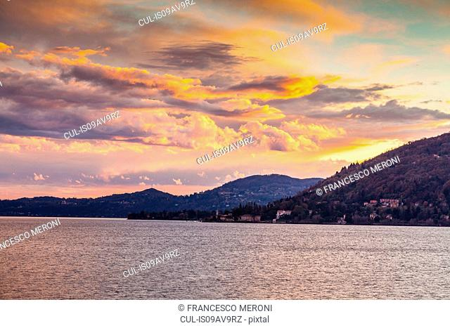 View of lake at dusk, Leggiuno, Lombardy, Italy
