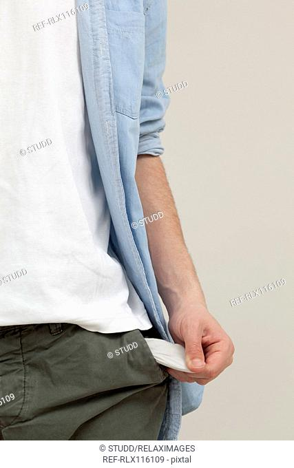 Close up of teenager with empty pockets