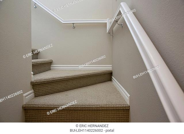 Close-up of stairs with handrail at home