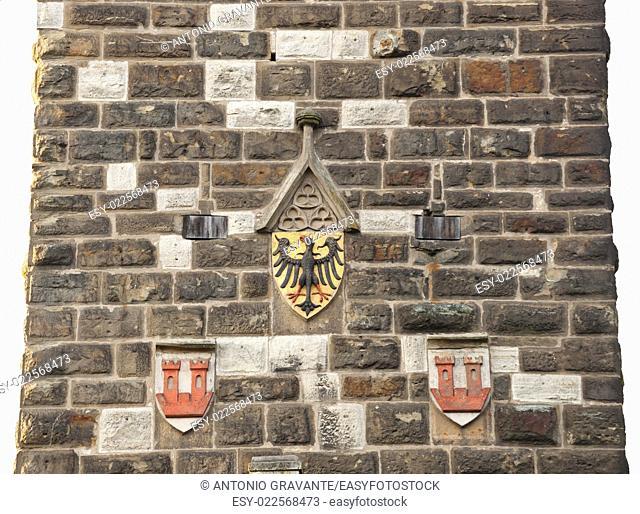 Antique eagles emblem on the wall of old tower in Rothenburg od der Tauber