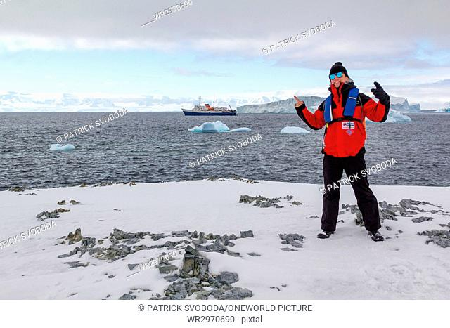 Antarctica, country tour on the Antarctic coast - A man poses in front of the expedition ship