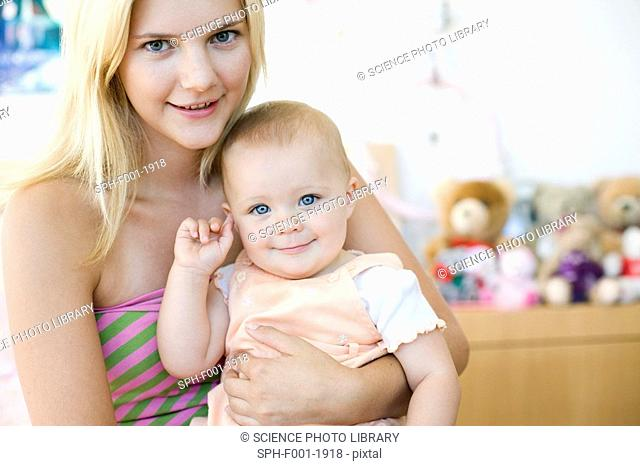 Teenage mother and baby