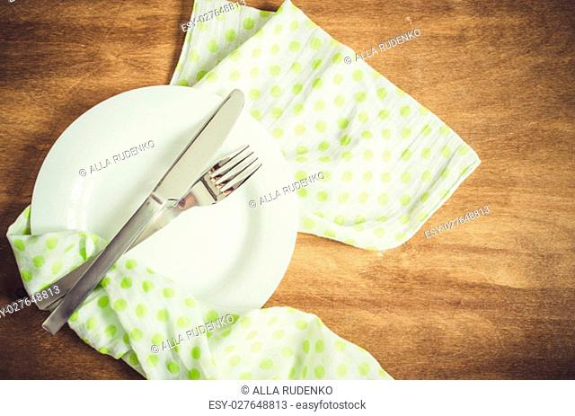 Spring Festive Table Setting with Cutlery and Napkin on Wooden Rustic Table. Selective Focus