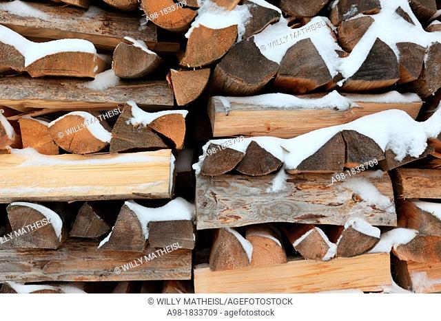 stack of firewood in winter at the village Prasily, German: Stubenbach, near Susice, Okres Klatovy, Bohemia, Czech Republic, Europe