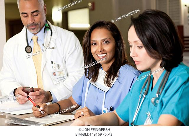 Doctors and nurse working in hospital