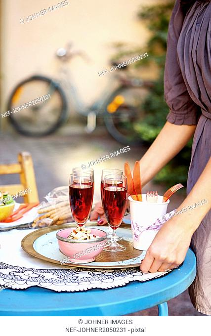 Woman with dessert on tray