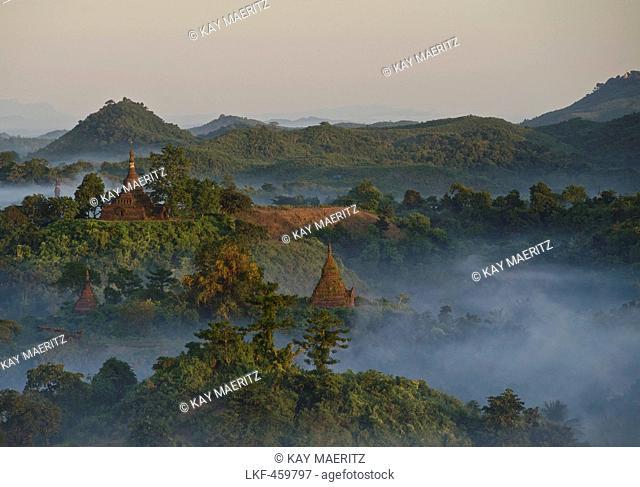 View over the hills and pagodas in the evening mist at Mrauk U, Myohaung north of Sittwe, Akyab, Rakhine State, Arakan, Myanmar, Burma