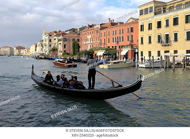 Japanese tourists in a gondola on the Grand Canal, Venice, Italy