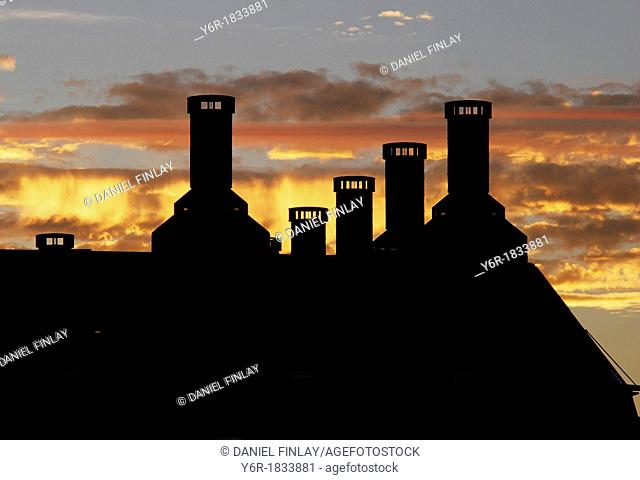 The roof of Portcullis House, the annex of the Houses of Parliament in London England, against a bright sunset  The roof, though modern
