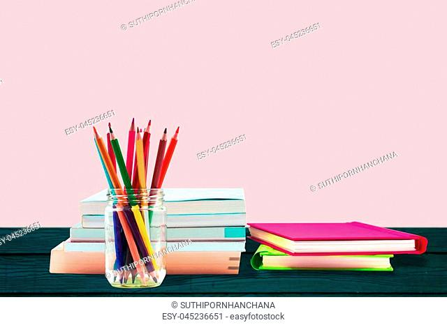 Books ,pen,pencil and office equipment on wood background, education and back to school concept
