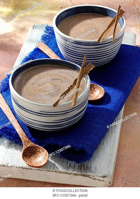 Two bowls of habichuelas con dulce caribbean soup editorial food