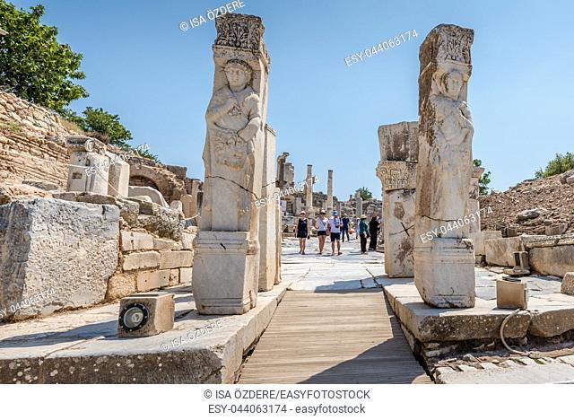 People visit Hercules Gate ancient ruins at Ephesus historical ancient city, in Selcuk,Izmir,Turkey:20 August 2017