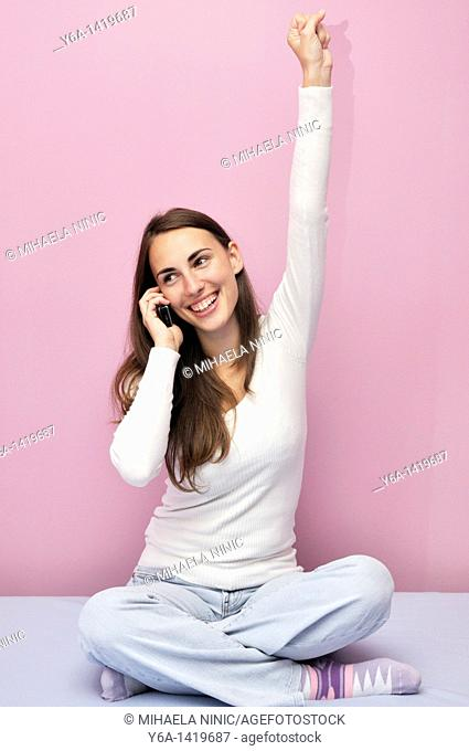 Happy young woman using cell phone