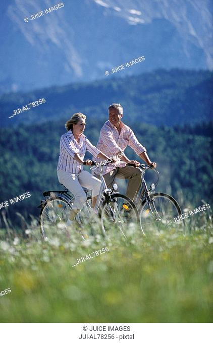 Couple riding bike in Germany