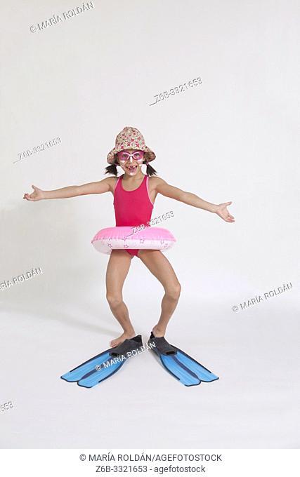 studio shot, swimsuit, swim ring, hat and flippers