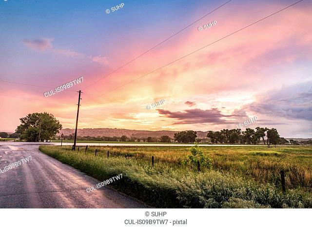 Sunset over rural landscape, Montana, US