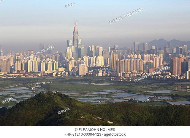 View across fishponds towards highrise buildings, looking towards Shenzhen City in Shenzhen Special Economic Zone across former Frontier Closed Area