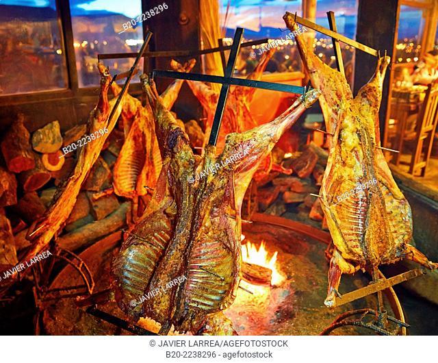 Patagonian lamb. Lambs roasting on spit. Don Pichon Restaurant. El Calafate. Santa Cruz province. Patagonia. Argentina