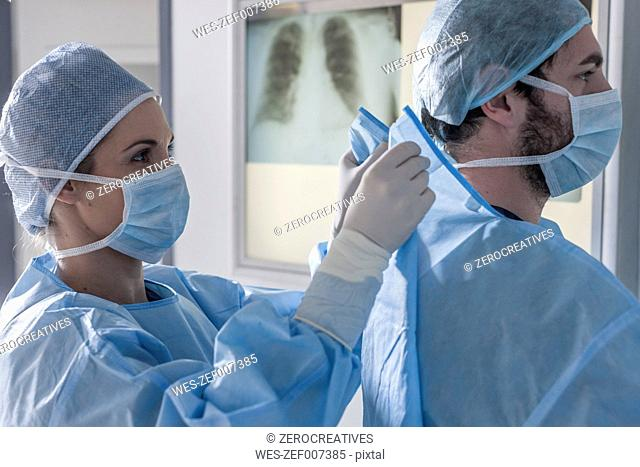 Two surgeons preparing for operation