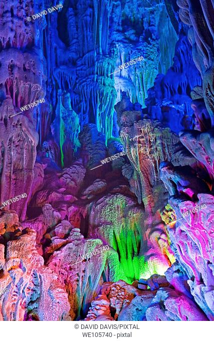 The beautifully illuminated Reed Flute Caves displaying the 'Morning Sunrise over the Lion Jungle' formations  Located in Guilin, Guangxi Provine, China
