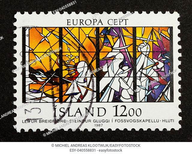 ICELAND - 1987: Stamp printed in Iceland shows colorful glass of the Fossvogschapel, 1987