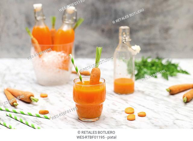 Refreshing carrot juice on marble