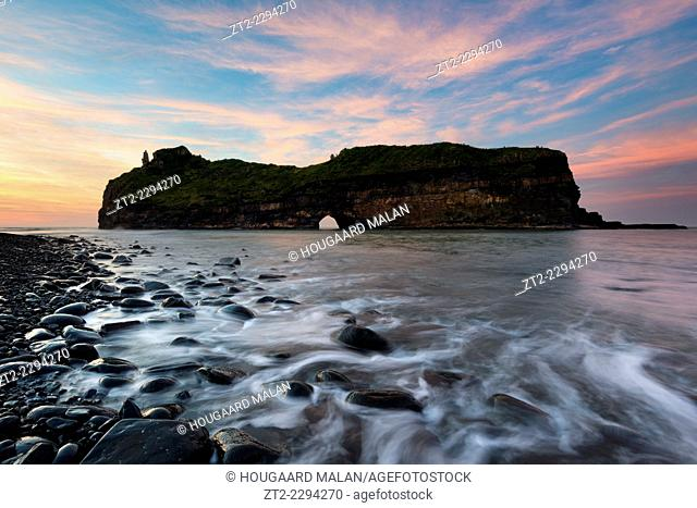 Landscape photo of a colourful sunrise scene at Hole in the Wall. Wild Coast, Eastern Cape, South Africa