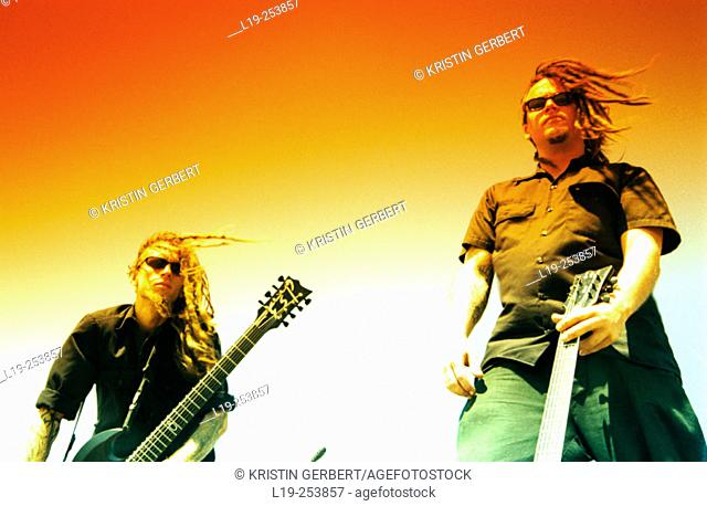 Alternative musicians with guitars