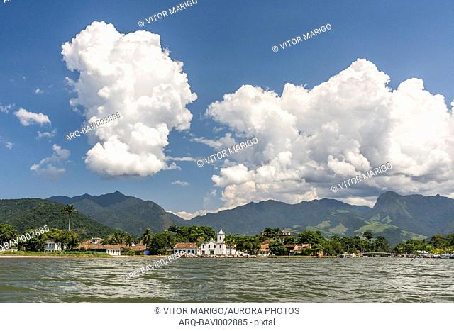 View of church and mountains on seashore in Paraty, Costa Verde, Brazil