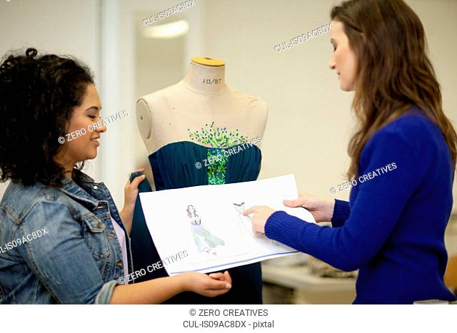 Fashion design students in discussion