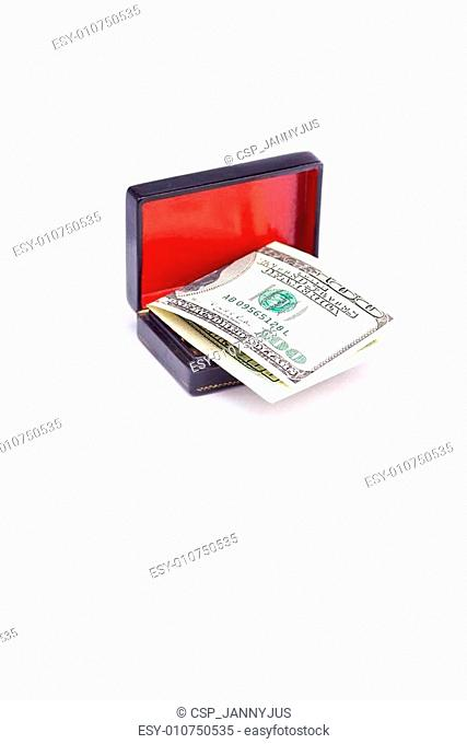 Dollars in the black box isolated on white