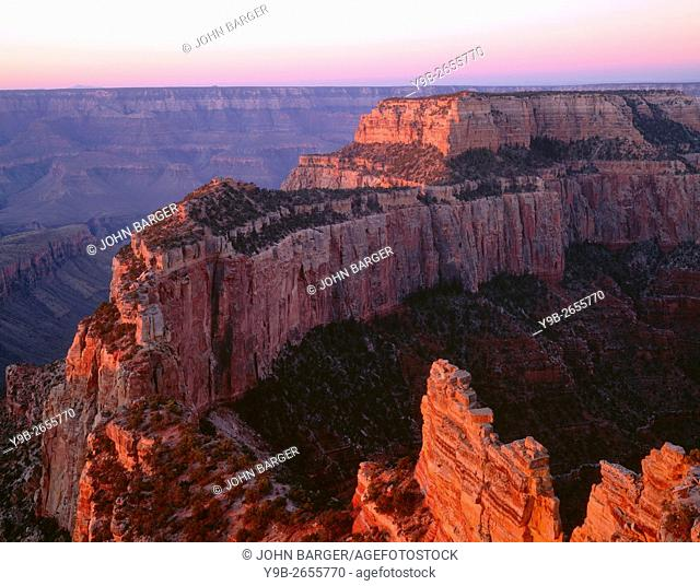 USA, Arizona, Grand Canyon National Park, North Rim, Sunrise light brightens Wotans Throne and surrounding canyon, from Cape Royal