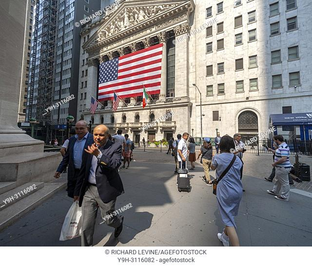 A giant American flag for Independence Day decorates the facade of the New York Stock Exchange on Tuesday, July 3, 2018. The stock exchange has a short trading...