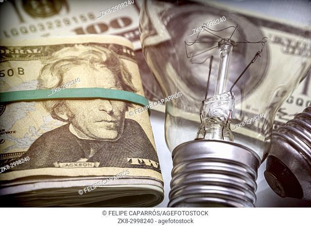 A lightbulb on dollar bill, energy saving concept