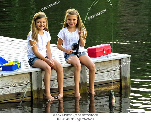Twin sisters catching fish