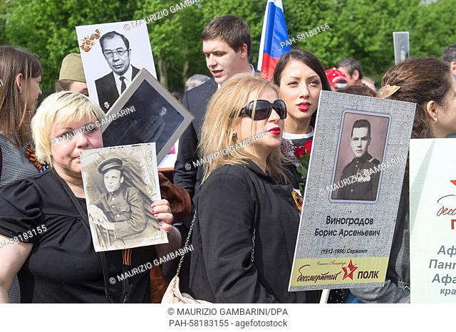 Relatives of Russian soldiers who died in the Second World War commemorate the end of the war at the Soviet Memorial in Berlin, Germany, 9 May 2015