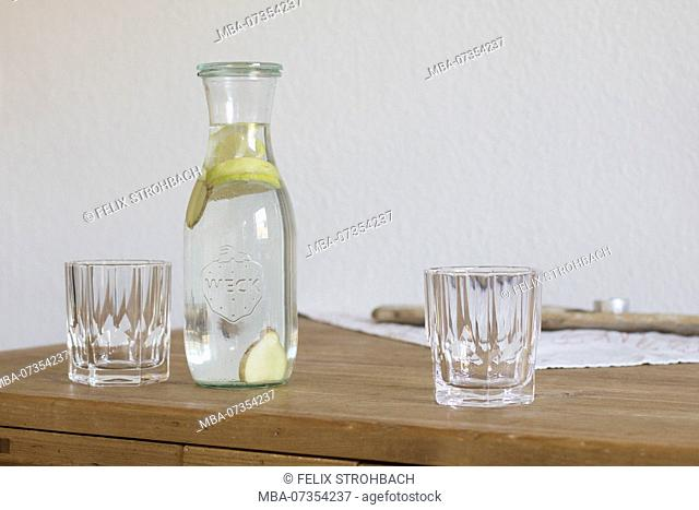 Glass carafe with two glasses