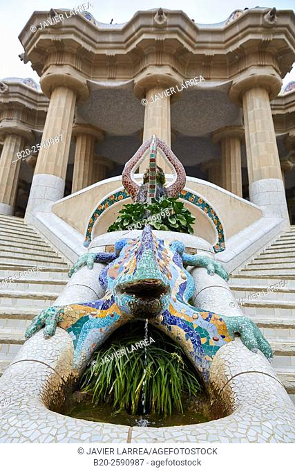 "Salamander sculpture (aka ""Drac"" or ""Dragon"" ) with Hypostyle hall in background. Park Güell by Antonio Gaudí. Barcelona. Catalonia. Spain"