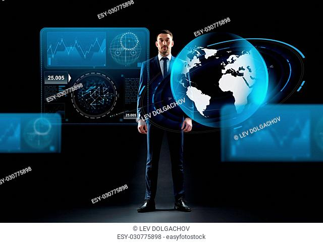 business, people and technology concept - businessman in suit with earth globe hologram over black background
