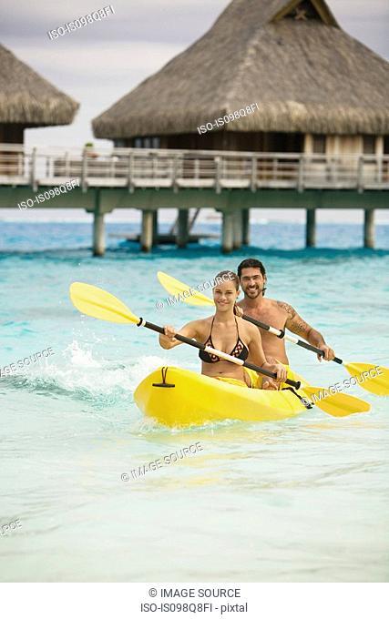 Couple in canoe in bora bora