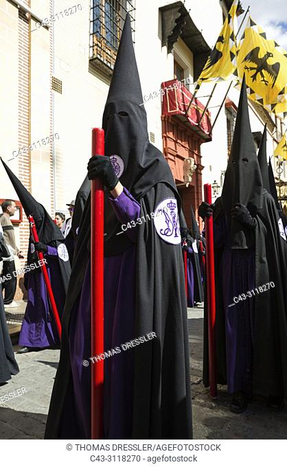 Penitents at the Semana Santa (Holy Week) of Seville. Seville province, Andalusa, Spain