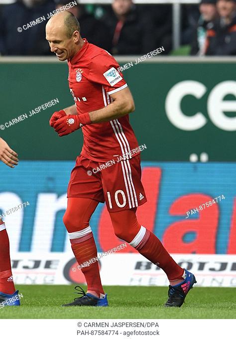 Munich's Arjen Robben celebrates his 0-1 score during the German Bundesliga soccer match between Werder Bremen and Bayern Munich at the Weserstadiumin Bremen