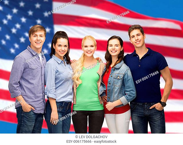 education and people concept - group of standing smiling students