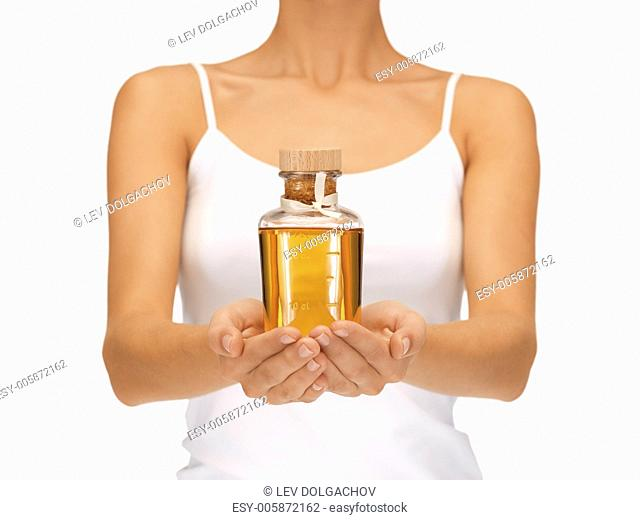 bright picture of female hands with oil bottle